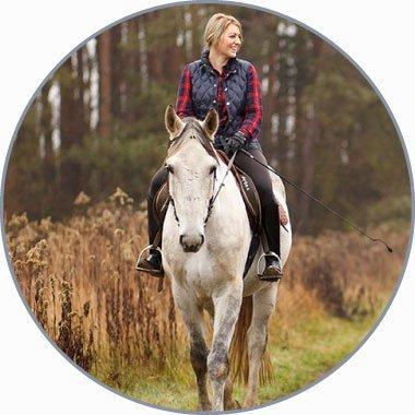 female horse back riding on mountain trails